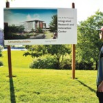 Hayden Crosby | Argonaut On his way to class Thursday, University of Idaho junior Tyler Bevans passes the sign proposing a new Integrated Research and Innovation Center.