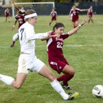 Philip Vukelich | Argonaut Katie Baran attempts to swing in a cross as a New Mexico State defender tackles.