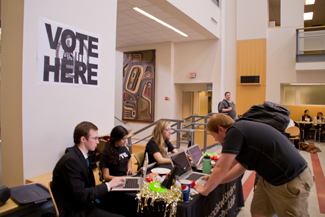 Abi Stomberg | Argonaut Tanner Perkins, University of Idaho political science sophomore, casts his vote during ASUI elections. The voting station was set up in the Idaho Commons Cafeteria Monday. Voting for the ASUI elections is open until Wednesday.