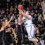 North Dakota senior center Emily Evers, right, attempts a layup against Idaho's defense. The Vandals fell to UND 68-62 Thursday in Grand Forks.