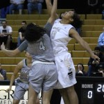 Junior post Ali Forde, right, goes up against Vikings guard Ani Avanessian for the tipoff during the game Saturday in the Cowan Spectrum. The Vandals beat the Vikings 77-49.