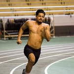 Senior sprinter Alijah Medellin rounds the corner at practice Wednesday in the Kibbie Dome. Idaho will compete in the WSU Open Friday and Saturday.