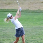 File photo by Nathan Romans | Argonaut  Senior Kaitlyn Oster follows through a shot in the fairway Sept. 22 during the WSU Cougar Cup. Oster and the Vandals won their first first tournament of the spring season Monday at the Delta Gamma Challenge in New Braunfels, Texas.