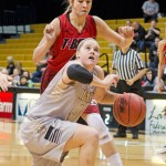 Nathan Romans | Argonaut  Senior guard Stacey Barr rises from the ground while maintaining her dribble during Idaho's 76-49 win against Southern Utah at 2 p.m. Saturday in the Cowan Spectrum. Barr passed Mary Raese in all-time scoring by finishing the night with 1,801 career points.