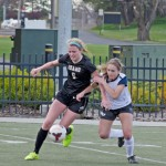 Nathan Romans | Argonaut  Defender/forward Olivia Baggerly fights a Gonzaga opponent for the ball during Idaho's 1-1 tie with the Bulldogs Saturday on the SprinTurf.