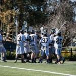 Brenda Ely | Argonaut  The Men's Lacrosse team celebrates a win in overtime against University of Washington Sunday afternoon.