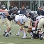 Senior running back Elijhaa Penny is pulled down by a host of Vandal defenders during Idaho's first scrimmage of the season Saturday at the SprinTurf.