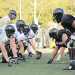 The offensive and defensive lines square off in a heated practice Wednesday on the SprinTurf.