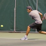 File photo by Nathan Romans | Argonaut  Freshman Felipe Fonseca returns a volley during practice Feb. 4 in the Kibbie Dome. Idaho men's tennis travels to Boise State and Utah State to round out the regular season.