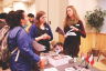 Yishan Chen | Argonaut  Sabrina Harris and Sara Nutsch (center) explain programs to Caila Zimmerman (left) at the Study Abroad Fair Wednesday.