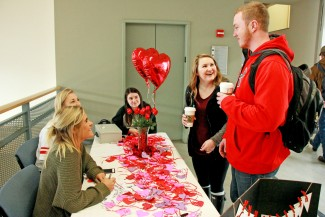 Yishan Chen | Argonaut  Sophomores Sarah Medina, Nikaya Johnson and Alyssa Wilson sell rose-shaped chocolate to sophomores Kassy Kirby and Cody Lewis on the third floor of the Idaho Commons Thursday.